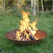 Lit fire pit in grass area