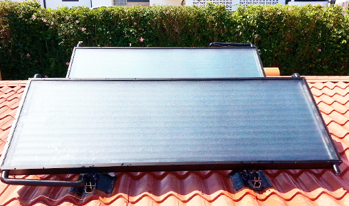 Two solar panels on a roof