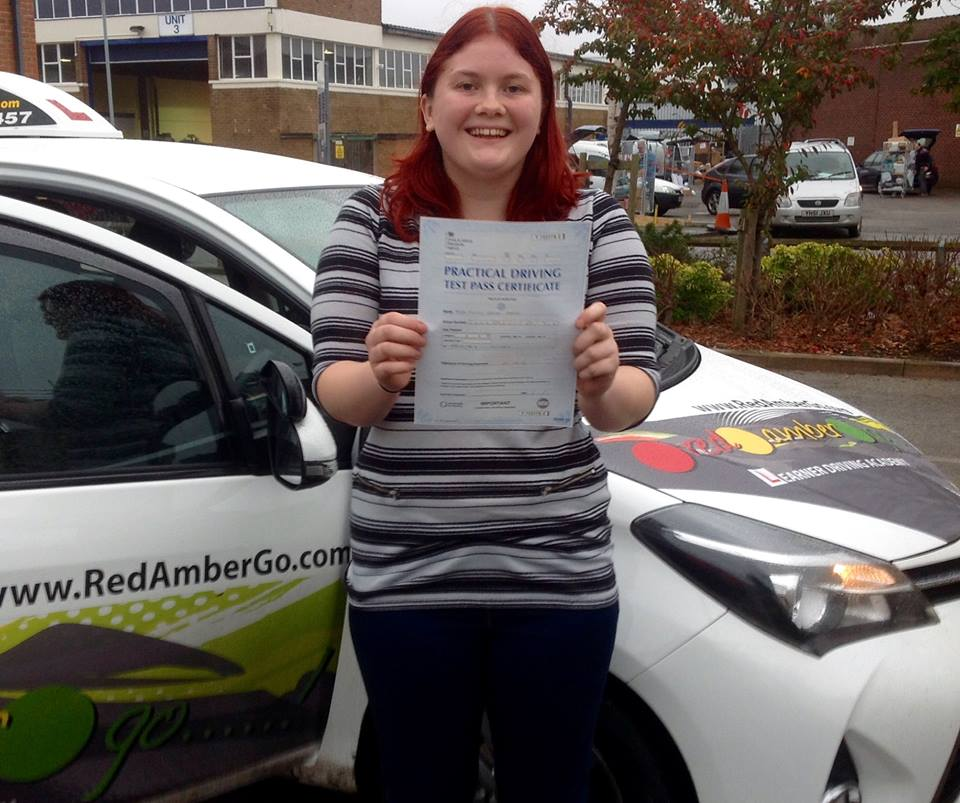 A lady  holding a certificate