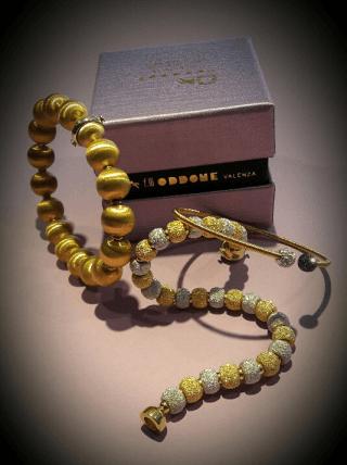 Bracciali in oro giallo bianco e rosso 18 kt