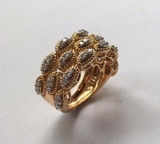 Fascia in oro giallo e bianco 18 kt con  diamanti