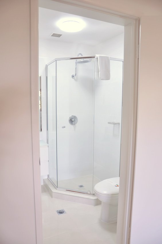 The modern bathroom with shower in our Two Bedroom Deluxe Apartment 9