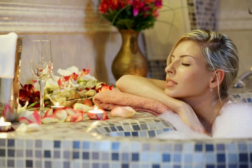 Woman enjoying a warm bath because of our water heating in Mornington