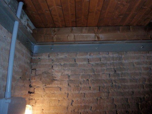 detail of joist support metallic frame for the new wooden floor