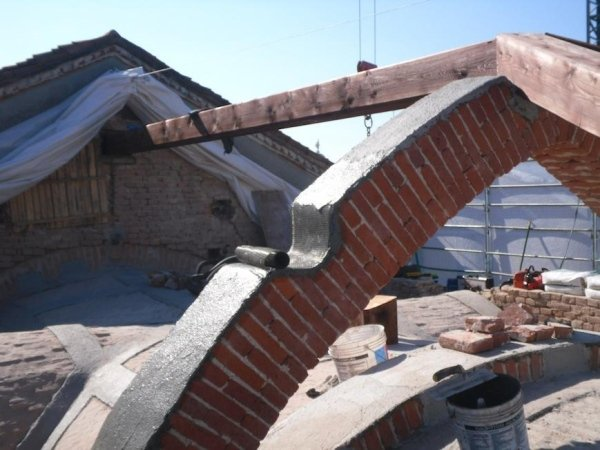 FRCM system for reinforcing arch masonry with PBO fibre