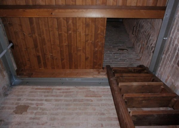 new wooden floor with metal profile perimeter frame and new access stairway