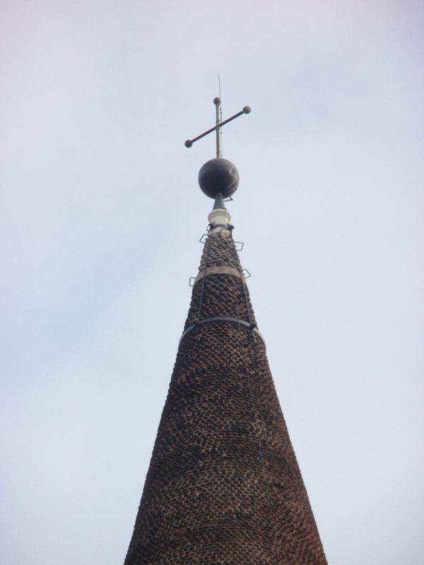 Detail view of spire tip with steel bands locking the vertical braces