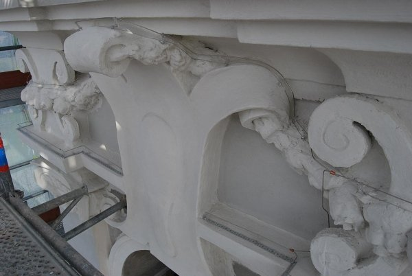 detail of restored concrete frieze and pigeon dissuader system