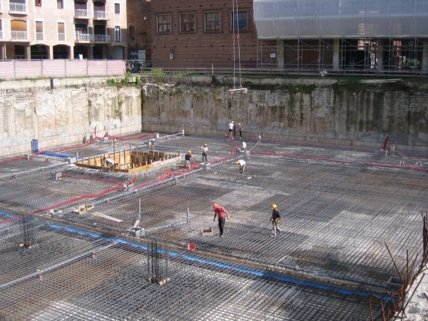 Setting foundation slab rebar with positioning of water collection pits