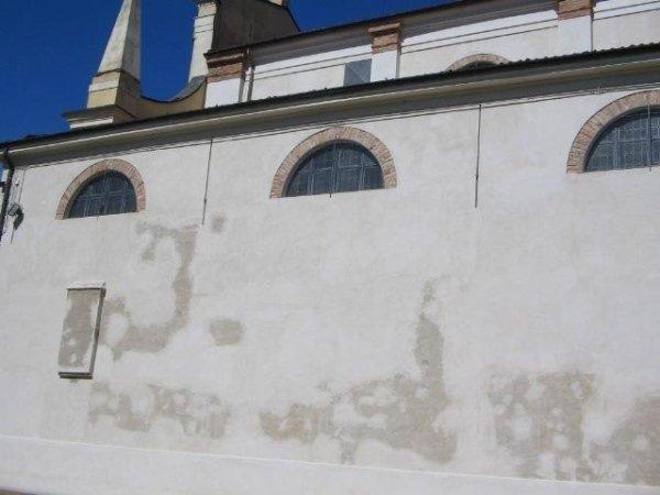 plaster restoration on the west elevation