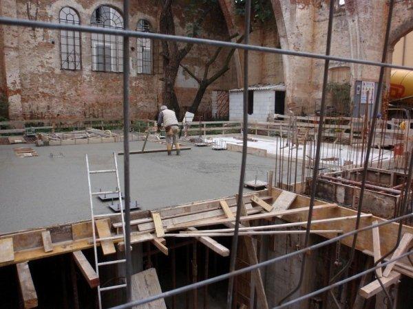 Basement reinforced concrete foundation slab and walls