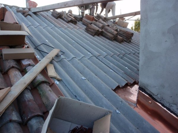 layer of tiles on corrugated sheeting