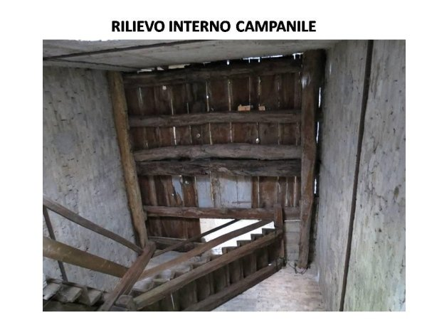 survey of bell tower interior: staircase leading to upper levels