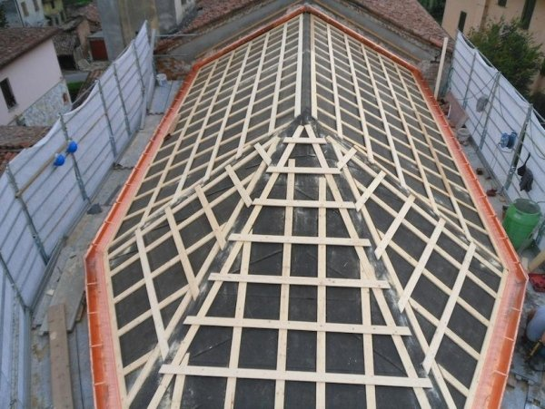 reinforced original rafters with layer of OSB panels, bracing and floor anchorages