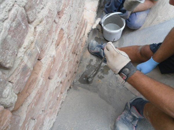 imlementing XJoints for for connecting the reinforcing fibres to the masonry