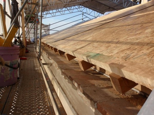 second layer of OSB panels laid on boarding