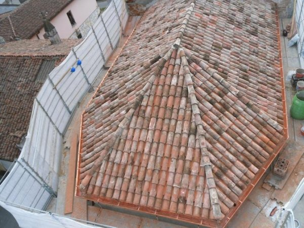 view of apse roof with laid waterproofing mambrane and lats for fixing corrugated sheets