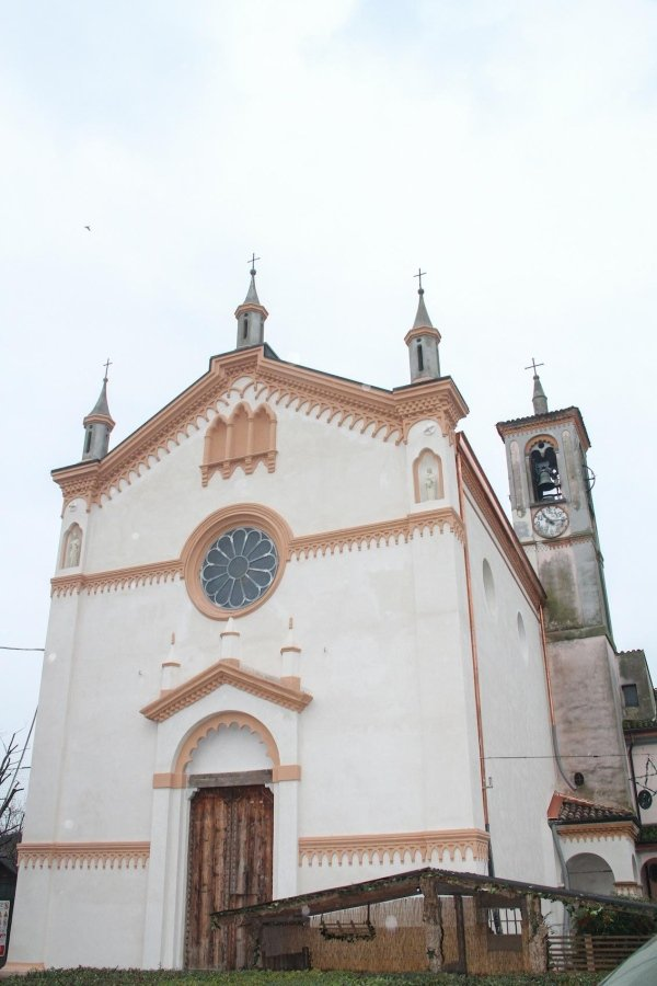 church façade after plaster restoration and painting