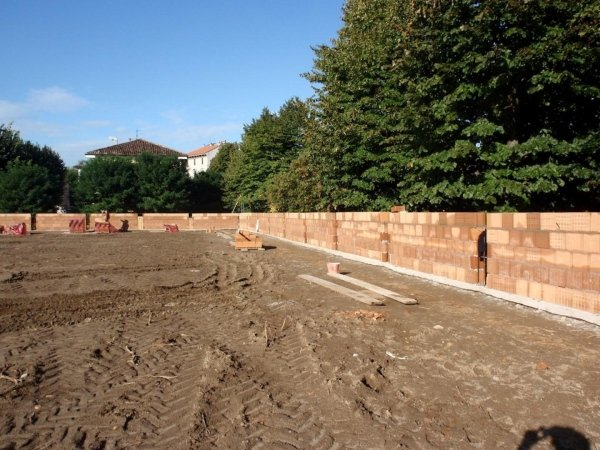 View of the retaining wall from the football field embankment