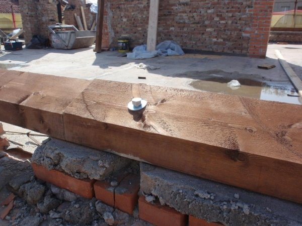 positioning wooden sleeper beams for joists and wall fixing