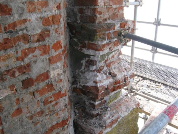 removal of plaster and brick elements that are unstable or in need of repair