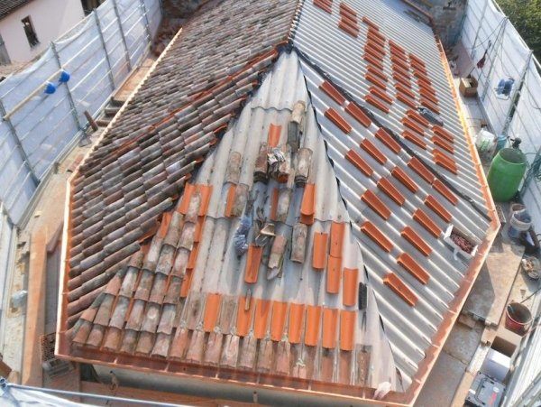 laying the roof tiles