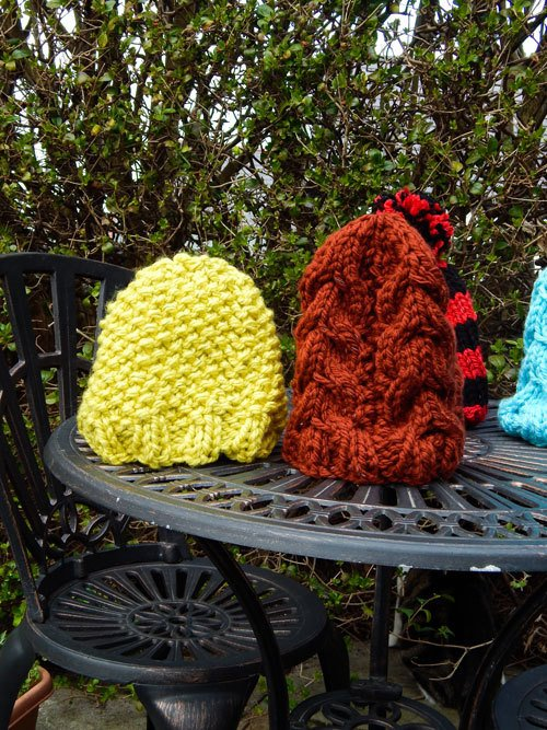 colourful glow in the dark beanies on a garden table