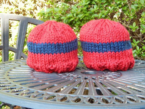Team Special colourful glow in the dark beanies on a garden table