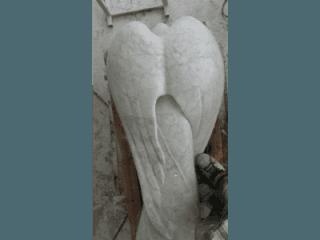 statua funeraria in marmo