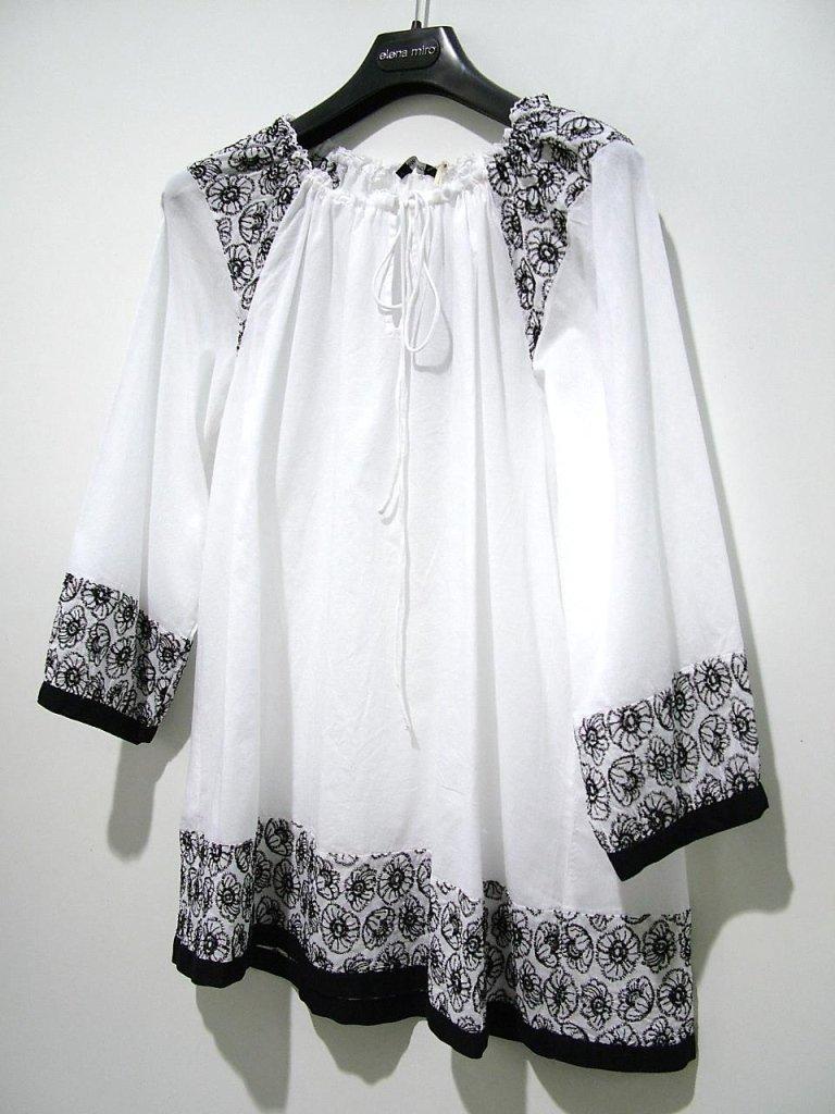 camicia bianca e nera