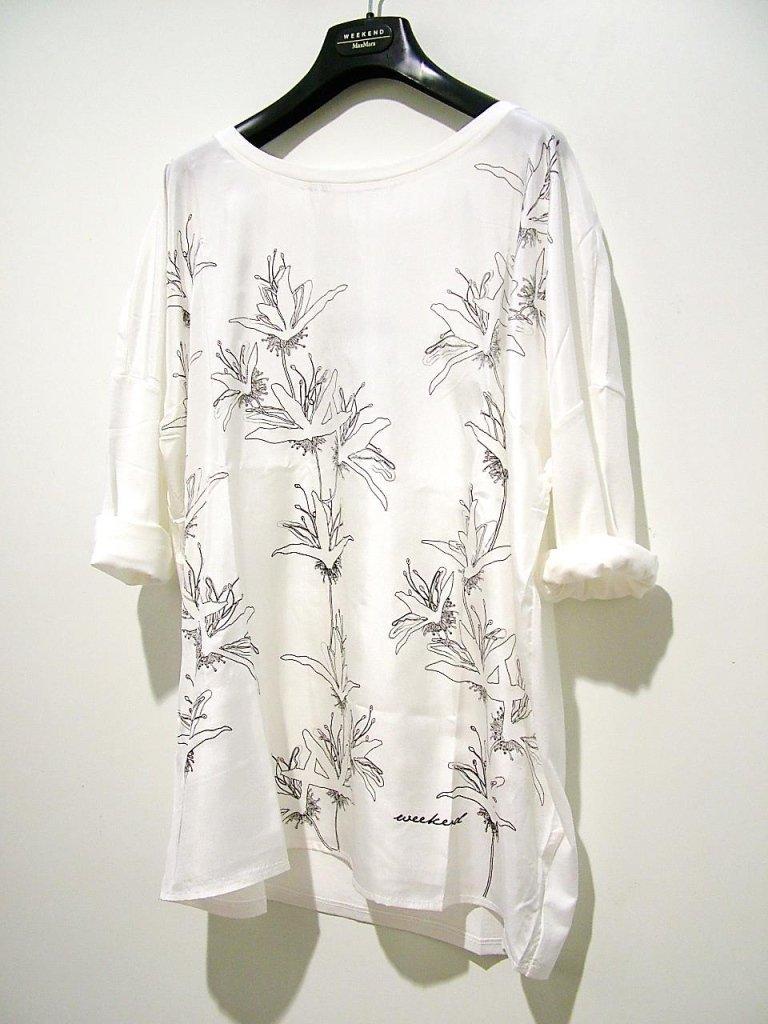 t-shirt bianca con fiori stilizzati