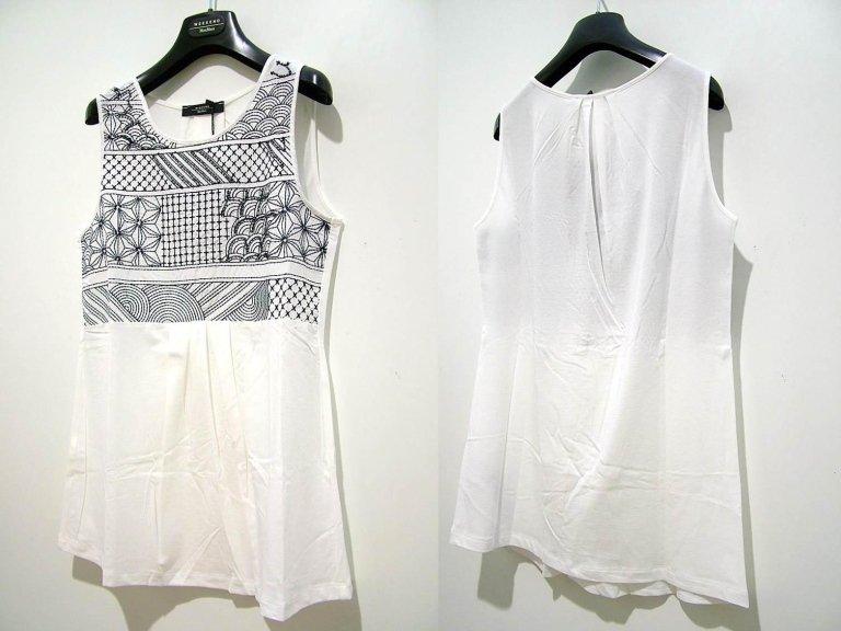 t-shirt bianca senza maniche con decorazioni geometriche