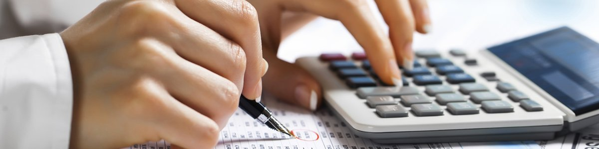 cma chartered accountants doing accounting with a calculator
