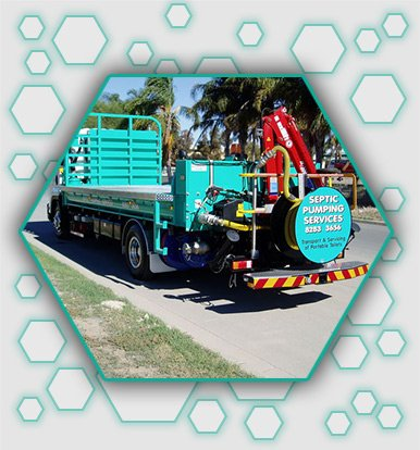 septic pumping services truck with business name and attached with equipment