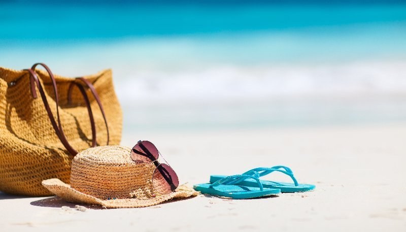hat and bag at the beach