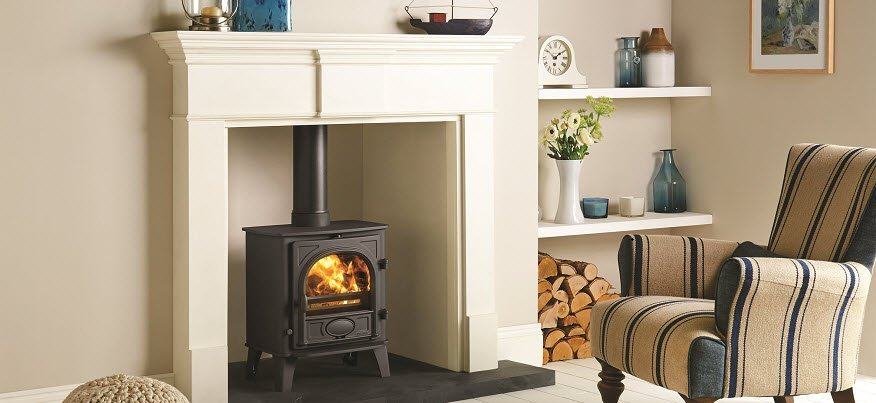 Traditional wood burning stove with mantel