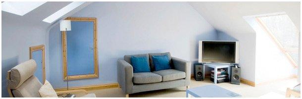A loft conversion with blue walls