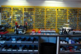 Our shop counter with keys displayed on a yellow wall