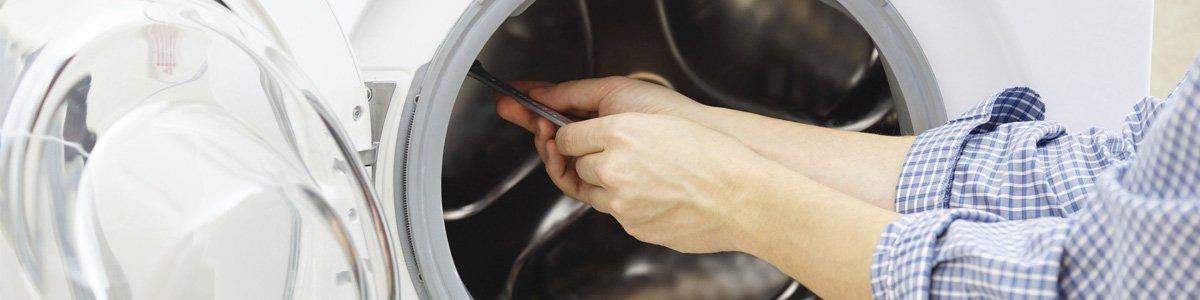 clarkes washing machine repairs man repairing machine
