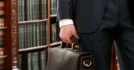 professional debt collector with suitcase