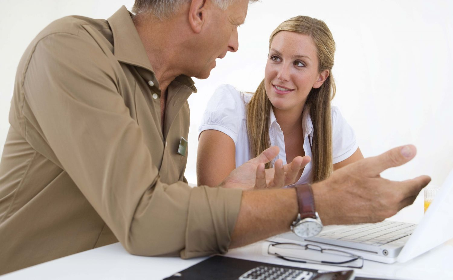 Man helping woman with accountancy services in Russellville, AR