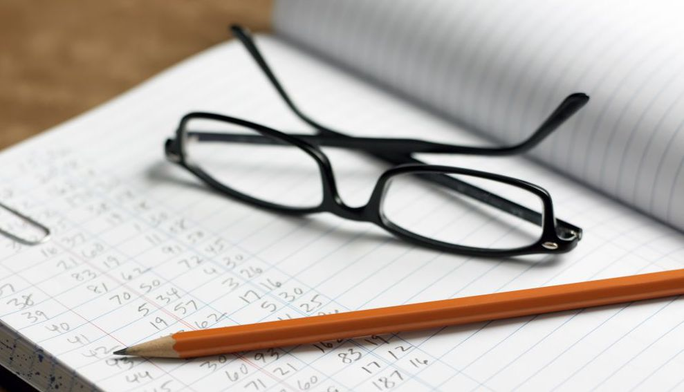 Glasses and pen resting on accountancy services book Russellville, AR