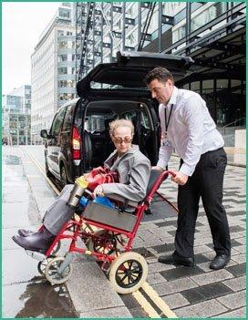 Q Despatch driver assisting patient