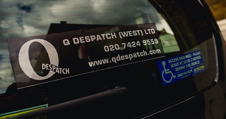 Q Despatch logo on windowscreen