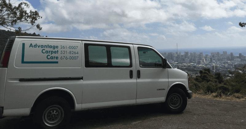Advantage Carpet Care van parked on a cliff