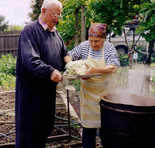 Old man and woman boiling noodles