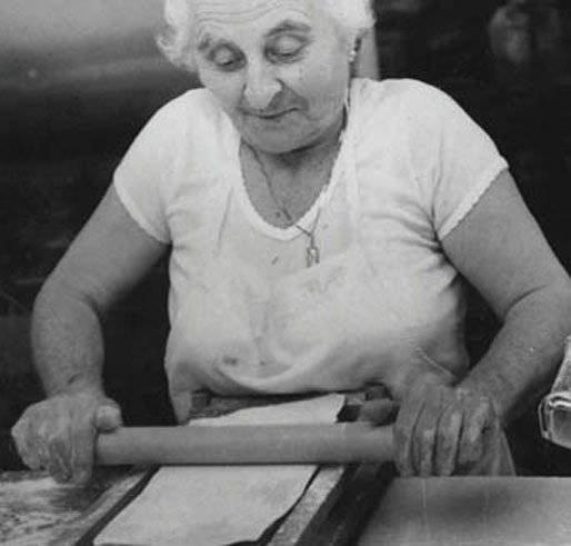 old lady working in the kitchen