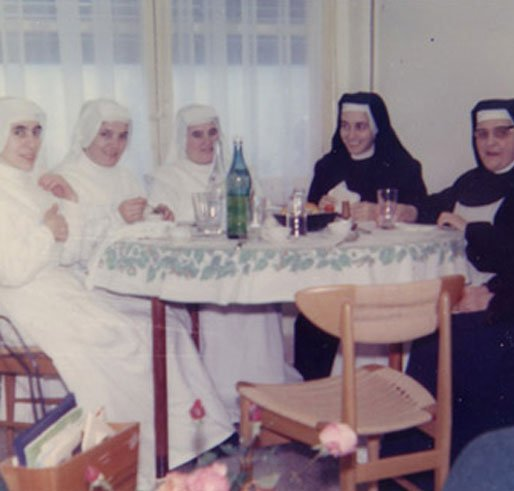 nuns sitting on the table