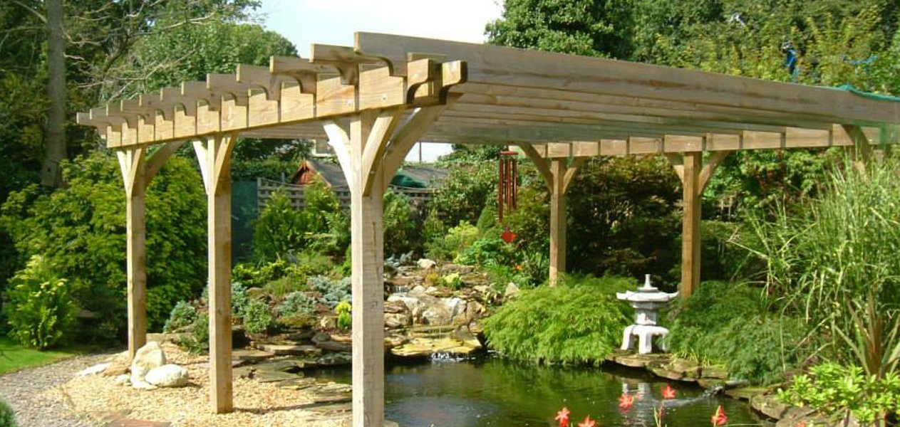 Pergola sites overlooking carp pond
