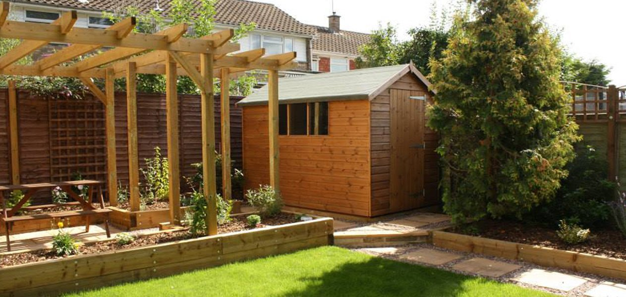 Garden shed next to pergola